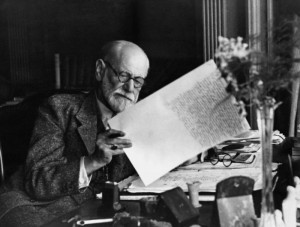 Sigmund Freud reading at a desk,1920